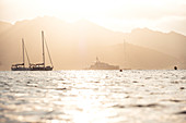 Boats and yachts in the evening light in front of Saint Florent, Corsica, France.