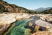 Bathers in Gumpen des Fango, Fangotal, Galeria, Corsica, France.