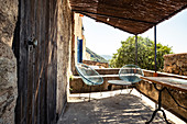 Terrace in the mountain village of Pigna near Calvi, Corsica, France