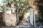 Gate entrance in the mountain village of Pigna near Calvi, Corsica, France