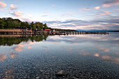 View of a deserted jetty on Lake Starnberg at sunset, in the background the Alps, Starnberg; Bavaria; Germany; Europe
