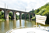 View from houseboat with Brittany flag to Viaduct bridge with arcade arches, Ille-et-Vilaine department, Brittany, France, Europe