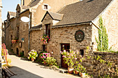 Stone house with shop, in front of large blooming flower pots, La Roche-Bernard, Vilaine, Morbihan department, Brittany, France, Europe