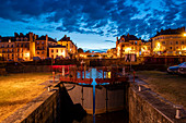 Illuminated house facades from Redon with lock to the Vilaine river at dusk, Redon, Ille-et-Vilaine department, Brittany, France, Europe