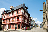 Red half-timbered house Feud'or cadeaux bretons on Place Notre Dame, Josselin, Dept. Morbihan, Brittany, France, Europe