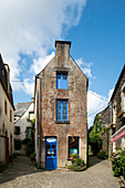Dreamy, narrow house with blue windows between two alleys in Rochefort en Terre, Morbihan, Brittany, France, Europe