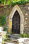 Historic door in the wall of the castle park, Rochefort en Terre, Morbihan department, Brittany, France, Europe