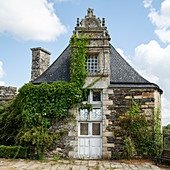 Building in the park of the Rochefort en Terre castle in summer, Morbihan department, Brittany, France, Europe