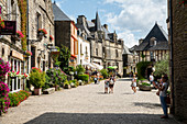 Romantic place du puits in summer with people, Rochefort en Terre, D? Partement Morbihan, Brittany, France, Europe