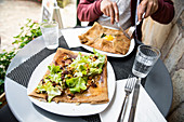 Breton galettes (stuffed buckwheat pancakes), or cr? Pes, hearty filled with lettuce, nuts and eggs in a restaurant, Rochefort en Terre, Morbihan department, Brittany, France, Europe