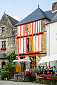 Red half-timbered house on the Place du Puits in summer, Rochefort en Terre, Morbihan department, Brittany, France, Europe