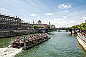 Tour boat on the Seine with a view of the Greffe du Tribunal de Commerce, the commercial court in Paris, France, Europe