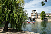 Excursion boat under the Pont Royal on the Seine in front of Porte des Lions with large pasture, Paris, France, Europe