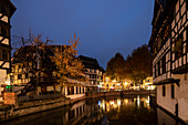 Traditional half-timbered houses on the canal in the La Petite France district during the blue hour, Strasbourg, Alsace-Champagne-Ardenne-Lorraine, France, Europe