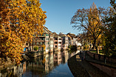 Traditional half-timbered houses on the canal in La Petite France district in autumn, Strasbourg, Alsace-Champagne-Ardenne-Lorraine, France, Europe