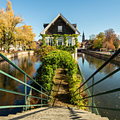 Central view from covered bridge (Ponts Couverts) to the idyllic Protection des Mineurs building, framed by canals in autumn, Strasbourg, Alsace-Champagne-Ardenne-Lorraine, France, Europe