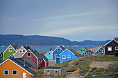 Narsaq; South greenland; typical, brightly painted wooden houses; View of Narsaq Bay with icebergs; Mountain landscape; nice weather
