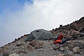 Kilimanjaro, Machame Route, Barafu Camp or Base Camp, 4673 meters high, thick fog and strong wind, in the late afternoon before climbing the summit