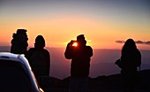 four people, photographer, sunset at Etna volcano, south side, east coast, Sicily, Italy