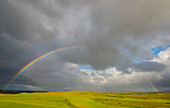 Rainbow over the golf course of Stykkishholmur, Snaefellsnes peninsula, Westfjords, Iceland