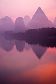 Limestone Karst Formations on River Li at Misty Dawn\nGuilin Region\nGuangxi, China\nLA008242