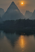 Limestone Karst Formations reflected in River Li\nGuilin Region\nGuangxi, China\nLA007970\n