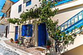 House with vines in the small town of Pirgos Kalo Horio, east Crete, Greece