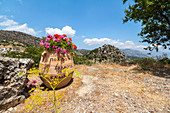 View of vase and round rock in the mountain village of Kalamafka, east Crete, Greece