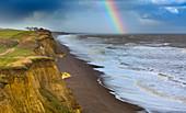 Rainbow off Weybourne Norfolk in rain storm