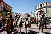 Guanajuato, Mexico - March 19, 2016: A group of man on their horses wearing tradional Mexican clothing at the local plaza.