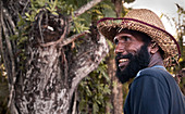 Papua New Guinea - November 12, 2010:  A smiling man with a beard is wearing a strawhat.