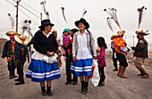 Arequipa, Peru - December 25, 2011: A group of people wearing festive clothing.