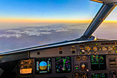 Sunrise in the cockpit of an Airbus over the Alps