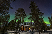 Cozy log cabin under northern lights, Luosto, Finland