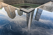 Reflection of the One World Trade Center in the 9/11 Memorial, New York City, USA