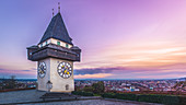 Sunset with a view of the clock tower, Graz, Austria