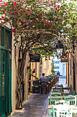 Taverns in historic narrow streets in the old town of Rethymno, North Crete, Greece
