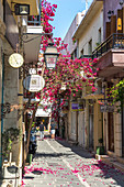 Historic streets with colorful flowers in the old town of Rethymno, North Crete, Greece