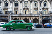 Green classic car in front of the Teatro de la Habana, Havana, Cuba