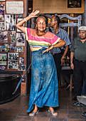 Elderly Cuban woman dancing in a bar in Santiago de Cuba, Cuba