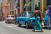 Woman walks through the streets of Santiago de Cuba, Cuba