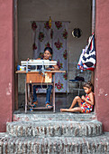 Mother and daughter in their own small shop in Camagüey, Cuba