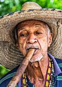 Cubans smoke a huge cigar in Camagüey, Cuba