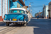 Blue classic car in the streets of Trinidad, Cuba