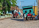 Tractor drives through Trinidad, Cuba