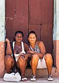 Two laughing Cuban girls, Trinidad, Cuba