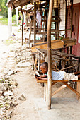 Kenyan child with smartphone, ruined city, Gede, Malindi, Kenya