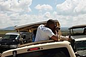 Touristen auf Safari, Nationalpark Masai Mara, Serengeti, Kenia