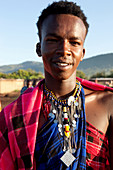 Young Masai with typical clothing, Safari, National Park, Masai Mara, Maasai Mara, Serengeti, Kenya