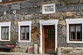 Stone facade of a traditional farmhouse near Wasserburg, Schambach, Benediktradweg, Upper Bavaria, Bavaria, Germany